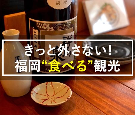 写真:テーブルに置いてある酒と皿